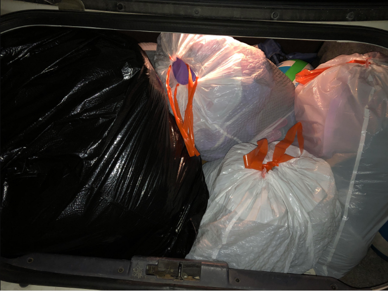 Trunk+full+of+clothes+donated+for+the+homeless+by+the+Grizzly+community.+