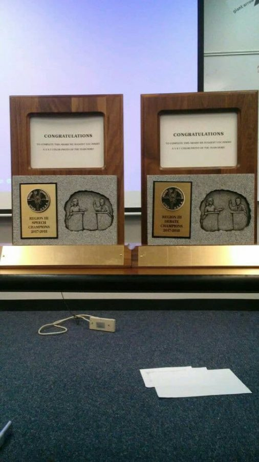 Region trophies for 'sweeps' in both the speech and debate categories.