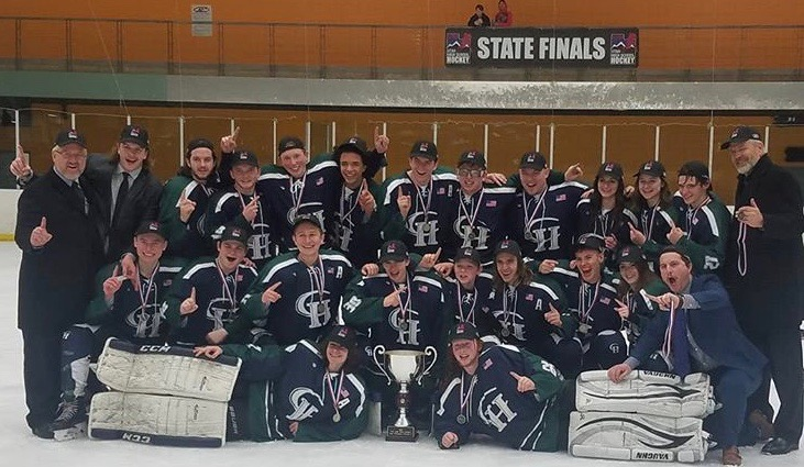 The Copper Hills Hockey team with their trophy after the huge win.