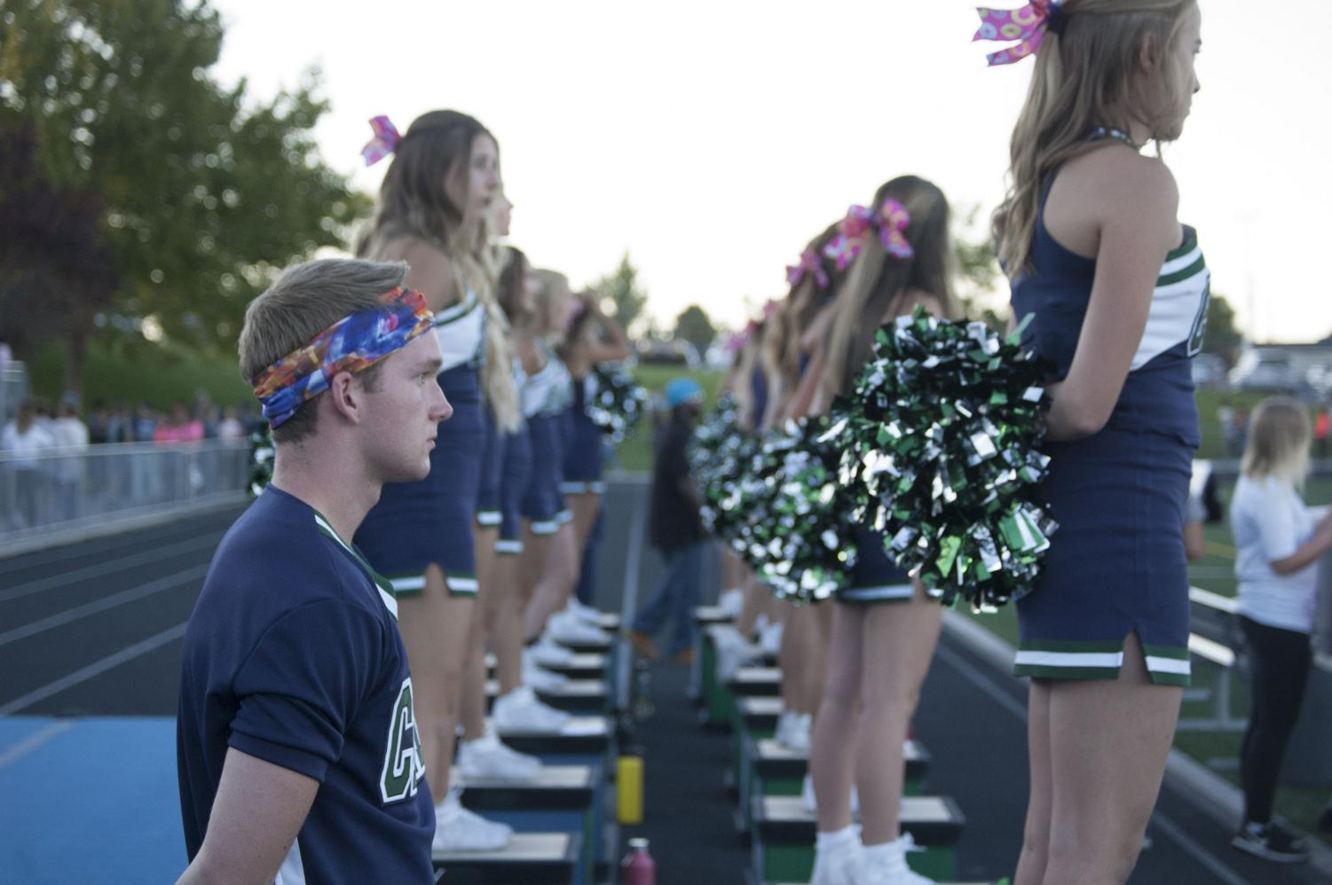 Ethan Worland (Left) is one of the male cheerleaders for Copper Hills.