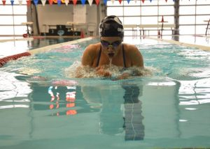 Junior, Charly Greenwood warms up for the Women's 100 Yard Breaststroke.