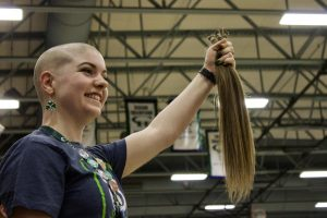 English teacher Amanda Tibbitts was one of a handful of faculty members to shave her head.