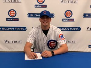 Porter Hodge signing his contract for the Chicago Cubs
